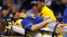 Toronto Blue Jays' J.A. Happ is attended to by medical personnel as he is taken off the field on a stretcher after being hit in the head by a line drive by Tampa Bay Rays' Desmond Jennings during the second inning of a baseball game Tuesday, May 7, 2013, in St. Petersburg, Fla. (Mike Carlson/AP Photo)