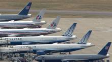 Airplanes sit at stands around the control tower at Heathrow Airport in London, Thursday Aug. 10, 2006. (TOBY MELVILLE/AP)