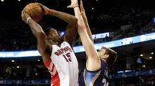 The Toronto Raptors Raptors Amir Johnson (15) tries for the basket against Memphis Grizzlies Marc Gasol (33) during play at the Air Canada Centre in Toronto on October 22, 2013. (Deborah Baic/The Globe and Mail)