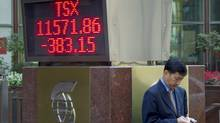 A TSX ticker in Toronto in September. So far this year, Canadian stocks have been one of the worst performers among 21 major bourses tracked by Bloomberg. (Chris Young/The Canadian Press/Chris Young/The Canadian Press)