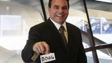 Toronto Councillor Giorgio Mammoliti holds the sign that reads 'Doug' that he taped over the 'Rob Ford' nameplate in council chambers on Tuesday, May 6, 2014. (Mark Blinch for The Globe and Mail)