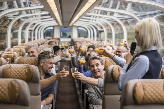 Travellers have a morning toast onboard a Rocky Mountaineer train.