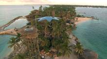 Several buildings at Nygard Cay, including its famous multistorey tree house were discovered engulfed in flames.