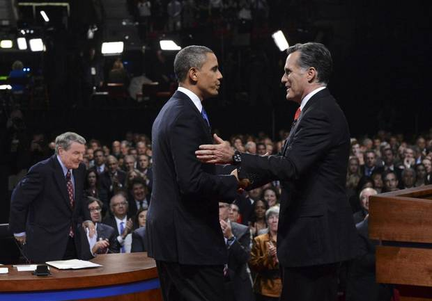 Republican presidential nominee Mitt Romney, right, shakes hands with President Barack Obama at the end of the first 2012 U.S. presidential debate in Denver, Oct. 3, 2012.