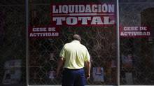 A man window-shops at a store going out business in Madrid on June 18. Spain called on Monday for the European Central Bank to fight financial market pressures on the euro zone. (SUSANA VERA/SUSANA VERA/REUTERS)