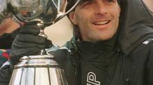 Toronto Argonaut quarterback Doug Flutie is all smiles holding the Grey Cup during a parade through downtown Toronto Tuesday in honour of their Grey Cup victory over Saskatchewan. (Fred Lum*/The Globe and Mail)