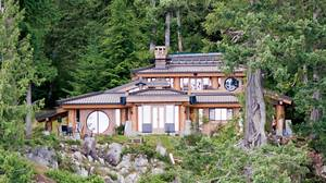 The amazing Gambier Island home of Bruce Ramus, former U2 show manager. Japanese pagoda crossed with a native longhouse. It's almost entirely made from cedar off the lot on which it sits. All the walls of the house are solid wood, 6