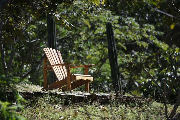 A Muskoka chair sits in the yard of Brian Pallister's Costa Rica vacation home.