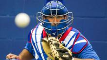 Toronto Blue Jays catcher J.P. Arencibia eyes the baseball at Jays Spring Training in Dunedin, Fla. on Sunday February 26, 2012. (Frank Gunn/CP/Frank Gunn/CP)