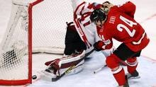 Switzerland's Reto Suri scores the winning goal against Canada's Mike Smith during the shootout (ARND WIEGMANN/REUTERS)