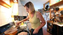 Naomi Duguid, author of a new cookbook called Burma, Rivers of Flavor, prepares the dish West Coast Mohinga at her home in Toronto. (Deborah Baic/The Globe and Mail)