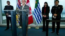 B.C. Minister of Justice and Attorney-General Suzanne Anton announces a $4.9-million compensation fund for children of the victims of serial killer Robert Pickton while Vancouver councillor Andrea Reimer and Vancouver Police Chief Jim Chu listen on March 18, 2014. (Darryl Dyck/The Canadian Press)