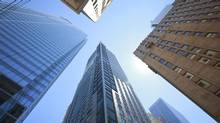 Skyscrapers that are home to big Canadian banks hover over a Bay Street intersection in Toronto. (Gloria Nieto/The Globe and Mail)