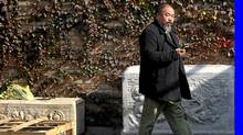 Dissident Chinese artist Ai Weiwei walks to the door of his home after talking to his lawyers in Beijing on Nov. 14, 2011. (David Gray/Reuters/David Gray/Reuters)