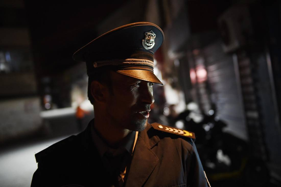 This April 17, 2015 photo shows a security guard in a Uyghur neighborhood in Aksu, in China's Xinjiang region.