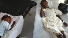Young children with cholera lie on cots as they are treated in Saint-Nicolas hospital where Doctors Without Borders (MSF) are treating cholera patients in St. Marc, Haiti. Haiti continues to deal with a cholera epidemic that has killed more than 1,000 and sickened thousands more. (Joe Raedle/Joe Raedle/Getty Images)