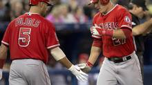 Los Anglees Angels Mike Trout (right) is congratulated by teammate Albert Pujols after hitting a solo homer off Toronto Blue Jays starting pitcher Dustin McGowan during third inning AL action in Toronto on Friday May 9, 2014. (Frank Gunn/THE CANADIAN PRESS)