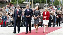 Canada's Prime Minister Stephen Harper (L) and his wife Laureen Harper (R) arrive alongside Britain's Prince William and his wife Catherine, Duchess of Cambridge at the National War Memorial in Ottawa June 30, 2011. (BLAIR GABLE / REUTERS/BLAIR GABLE / REUTERS)