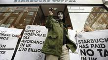 Earlier this winter, demonstrators descended on a London Starbucks to protest the company's lack of corporate tax payments in Britain over the past three years.<252> (Luke MacGregor/Reuters)