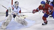 In this file photo, Montreal Canadiens' Jeff Halpern tries to deflect the puck past Washington Capitals goalie Braden Holtby during first period NHL hockey action Tuesday, March 15, 2011 in Montreal. Montreal claimed Halpern off waivers from the New York Rangers on Saturday. (Paul Chiasson/The Canadian Press)