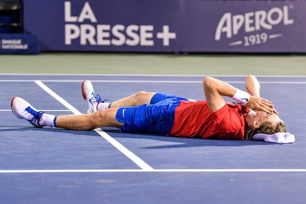 MONTREAL, QC - AUGUST 10: Denis Shapovalov of Canada falls to the ground after his victory over Rafael Nadal of Spain during day seven of the Rogers Cup presented by National Bank at Uniprix Stadium on August 10, 2017 in Montreal, Quebec, Canada. Denis Shapovalov of Canada defeated Rafael Nadal of Spain 6-3, 4-6, 6-7. (Photo by Minas Panagiotakis/Getty Images)