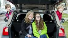 Jen Twyman would love a screen in the back seat so that her kids – Sasha 15, Jonah 12, and Seamus, 10 – won't ask 'Are we there yet?' (Chris Bolin for The Globe and Mail)