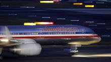 An American Airlines jet taxis on a runway as it takes off at Logan International Airport in Boston. (Elise Amendola/AP)