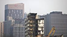 Excavators demolish an old building for a new development project at the Central Business District in Beijing on Feb. 28, 2012. China needs a new economic strategy after three decades of rapid growth. (Andy Wong/Andy Wong/Associated Press)