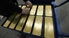 Despite investors balking at falling prices, one gold manager see a long-term bull market. A worker places ingots of 99.99 percent pure gold at the Krastsvetmet nonferrous metals plant in Russia's Siberian city of Krasnoyarsk April 12, 2012. Krastsvetmet is one of the world's largest players in the precious metals industry.   (ILYA NAYMUSHIN/REUTERS)