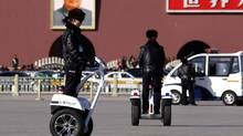 Policewomen ride motorised vehicles on Tiananmen Square in Beijing March 3, 2011. (David Grau/Reuters)