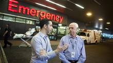 Kevin Eastwood, director and co-executive producer of Emergency Room: Life and Death at VGH, chats with Dr. Doug McKnight, right, outside Vancouver General Hospital. (Rafal Gerszak For The Globe and Mail)