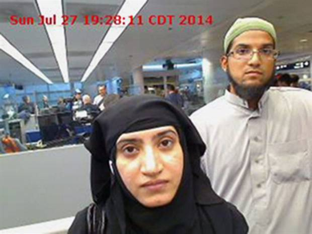 A July 27, 2014, file photo provided by U.S. Customs and Border Protection shows Tashfeen Malik, left, and her husband, Syed Farook, at O'Hare International Airport in Chicago.