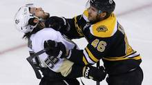 Boston Bruins' David Krejci shoves Pittsburgh Penguins' Kris Letang (BRIAN SNYDER/REUTERS)