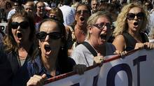 Public sector employees demonstrate outside the Greek Parliament on September 21, 2011. (LOUISA GOULIAMAKI/AFP/Getty Images)