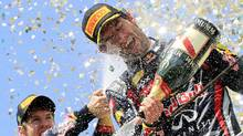Red Bull Formula One World Champion Sebastian Vettel (L) sprays champagne on the podium on teammate Mark Webber of Australia during the Brazilian F1 Grand Prix at the Interlagos circuit in Sao Paulo November 27, 2011. Webber won the race while Vettel was second. (© Nacho Doce / Reuters/REUTERS/Nacho Doce)