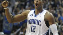 Orlando Magic's Dwight Howard reacts as the Magic defeat the Cleveland Cavaliers 116-114 in overtime during Game 4. (Phelan Ebenhack)