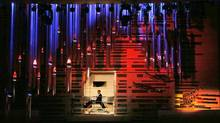 Organist Olivier Latry spins on his bench to acknowledge the crowd following his inauguration of the Pierre-Beique organ made by the Casavante Frere at the MSO in Montreal, May 28, 2014. (Christinne Muschi For the Globe and Mail)