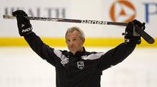 Los Angeles Kings head coach Darryl Sutter holds his stick above his head during a team practice. The Kings face the Devils in Game 6 at The Staples Center on Monday night. (Adam Hunger/REUTERS)