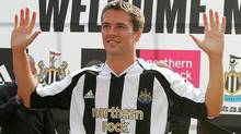 England striker Michael Owen wears a Newcastle United shirt after his signing by the club at St James' Park in Newcastle, August 31, 2005. (Reuters)