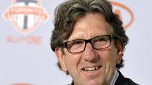 Paul Mariner smiles after being announced as the new Head Coach and Director of Soccer Operations for MLS Toronto FC during a news conference in Toronto June 7, 2012. (MIKE CASSESE/REUTERS)