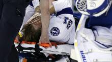 Tampa Bay Lightning center Steven Stamkos is taken off the ice on a stretcher after banging into the goalpost during the second period of an NHL game against the Boston Bruins in Boston Monday, Nov. 11, 2013. (Elise Amendola/AP)