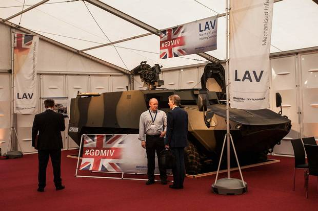 David Hind, right, with a LAV at the London conference; his current brief is to persuade the British Army to buy.