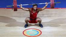 In this image taken Sunday July 27, 2014 Papua New Guinea's Toua Udia competes in the Clean and Jerk of the men's 77kg Weightlifting at the Clyde Auditorium during the 2014 Commonwealth Games in Glasgow Scotland. (Andrew Milligan/AP)