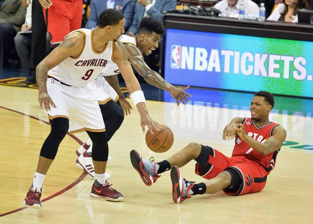 Kyle Lowry #7 of the Toronto Raptors attempts to pass the ball against Iman Shumpert #4 of the Cleveland Cavaliers and Channing Frye #9 during the second half in game two of the Eastern Conference Finals