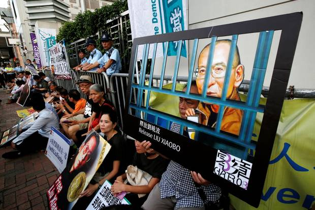 Pro-democracy activists stage a sit-in protest demanding the release of Nobel laureate Liu Xiaobo, outside China's Liaison Office in Hong Kong.