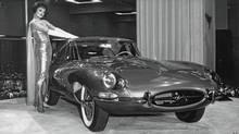 Playboy centrefold Marilyn Hanold and the new Jaguar E-Type at the 1961 New York International Auto Show. (Jaguar)