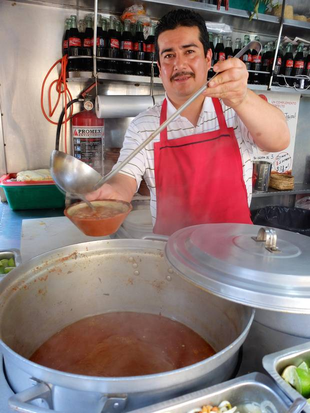 Street birria, stewed beef tacos accompanied by a spicy tomato and onion broth, is praised locally as a potent hangover cure.