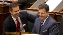 Ontario Premier Dalton McGuinty, left, and Finance Minister Dwight Duncan share a smile after delivering the province's budget at Queen's Park on Tuesday. (Peter Power/The Globe and Mail)