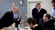 Anders Behring Breivik, seated right, confers with his defence lawyer Geir Lippestad, left, in the courtroom in Oslo Wednesday morning May 16, 2012. (Stian Lysberg Solum/AP/Stian Lysberg Solum/AP)
