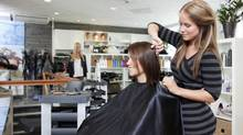 Hair salon, lady getting her hair cut. (Photos.com)